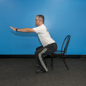 A chair squat is a good exercise to add to your strength routine.
