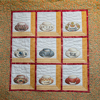 No two teacups are alike in this quilt by Daryl Kreindel. Compassionate care