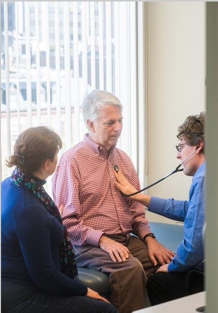 Stephen (center) and Jane visit with neurologist James D. Berry, MD, MPH, at the Mass General ALS Multidisciplinary Clinic.