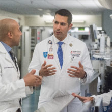 Ali Raja, MD, vice chair of the Department of Emergency Medicine (center) confers with emergency physicians Alister Martin, MD, (left) and Kamal Medlej, MD.