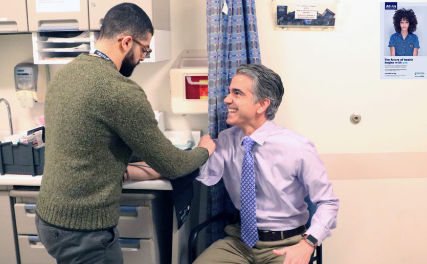 Dean Xerras, MD, (right) and research assistant Greg Alfaro are enrolling participants in the All of Us Research Program at Mass General, which aims to build large data sets that reflect the nation's diversity.