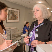 Former MGH Neurology Chief Anne B. Young (right) continues to mentor the likes of Jessica Tran, a college intern in the department.