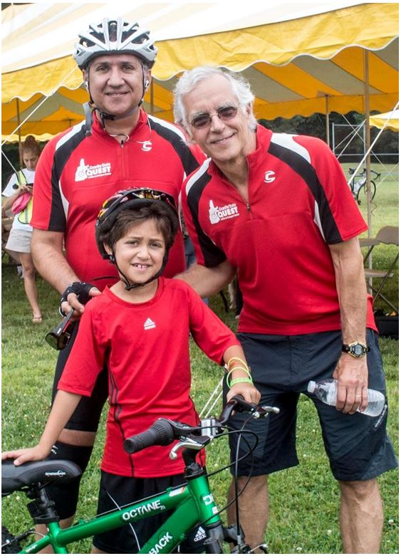 Ario with his dad, Naveed Nour (standing, left) and MGHfC pediatric oncologist Howard Weinstein, MD, after the 2011 Granite State Quest.