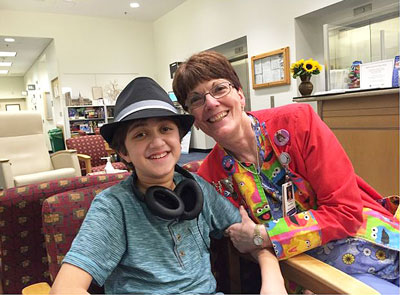 Ario and his nurse, Rachel Bolton, RN, at the The MGH Francis H. Burr Proton Beam Therapy Center in 2015