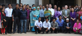Richelle Charles, MD, (center in green wrap) in Bangladesh at the International Center for Diarrheal Disease Research.. typhoid fever