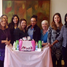 Jennifer Tan, MD (fourth from left), and Diana Webster Bartenstein (third from right) with Dermatology doctors, staff and residents with Share Your Beauty items.