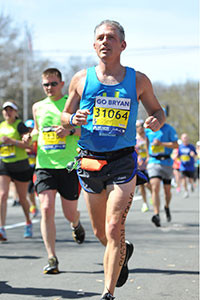Running strong, Bryan Rafanelli competes in the 2014 Boston Marathon to benefit pediatric cancer patients at MassGeneral Hospital for Children.