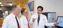 Cure Alzheimer's Fund founder Jeff Morby (left) and president and CEO Timothy Armour (center) join director of the MGH Aging and Research Unit, Rudolph Tanzi, PhD, in his laboratory.