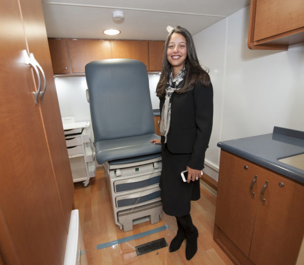 Elsie Taveras, MD, MPH, executive director of The Kraft Center, visits the CareZONE van at its recent unveiling.
