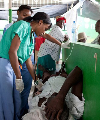 Infectious disease specialist Richelle Charles, MD, treats a patient in Haiti during a cholera outbreak. Typhoid fever
