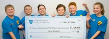 JMJK Enterprises presents a check to the Mass General/North Shore Cancer Center