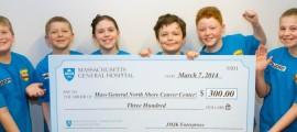 JMJK Enterprises presents a check to the Mass General/North Shore Cancer Center