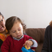 Tania Soares (right), an infant/parent specialist at MGH Chelsea, visits with Deisy Ortiz and her son, Danny.
