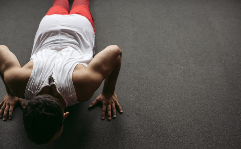 Push-ups are a good exercise for a cold weather workout. A half foam roller can be used, but it is not necessary.
