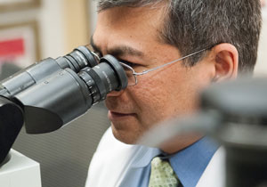 The work of pathologist Vikram Deshpande, MBBS, was crucial in identifying the new disease.