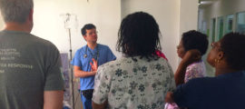 Mass General's Global Disaster Response team leader Kevin Murphy, RN, far left, and Juan Pablo Domecq Garces, MD, meet with colleagues in the Dialysis Unit of Dominica's Princess Margaret Hospital.