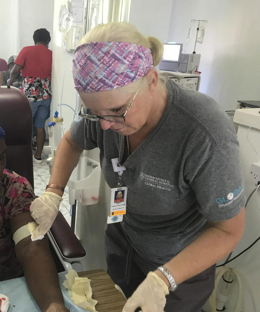 Roberta Culbert-Costley, MSN, administers dialysis to a patient in Dominica.