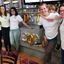 (L-R) Alex Linden, Christine Treseler, Delmis Urquiza, Jess Garton, her son Quinlan and Caitlin Miller at a Marathon fundraiser in February, the only event they were able to work on together before COVID-19.