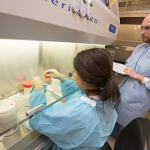 Akita Joshi (left) and Derek Bielawski, both senior medical technicians, took part in a recent drill to practice Ebola readiness procedures at Mass General's Microbiology Biothreats Laboratory.