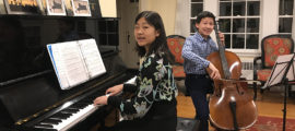 From their living room, Elizabeth and Ethan Qian-Tsuchida play classical duets and post them on their fundraising page.