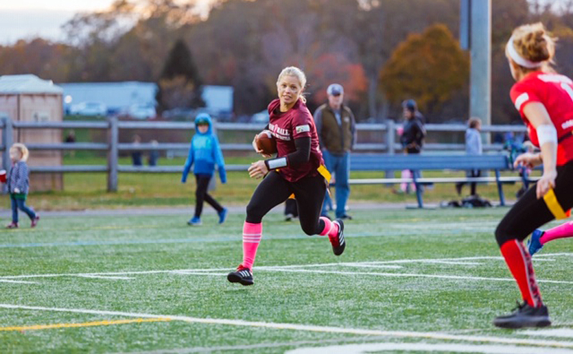 Erin Finelli on the run at the Mom Ball: Battle for the Battle! flag football game at the Pingree School in South Hamilton.