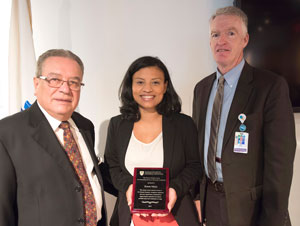 In 2015, MGH community health worker Karen L. Mejia received an annual award named in honor of Dr. Gonzalez-Martinez for her service to the Latino community. Pictured with her are Dr. Gonzalez-Martinez (left) and Jeff Davis, senior vice president of Human Resources.