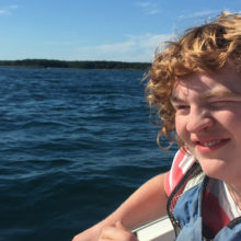 Ethan Datsis at his favorite place - his family's boat - one year after his surgery. (Photo courtesy of Ellen Datsis.)