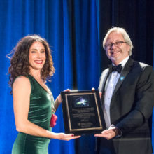 Vanessa White presents Brad Dickerson, MD, with a plaque in honor of her late father, Dennis White, an advocate for FTD research, and all of the patients and families who make frontotemporal disorders research possible.
