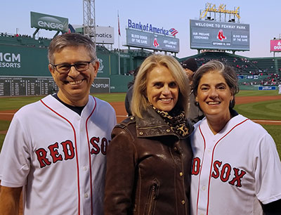 L-R: Jeffrey Ecker, MD, Vincent Club member, Donna Quirk, and Vincent Club President, Mary Feeny at Fenway Park in September 2019.
