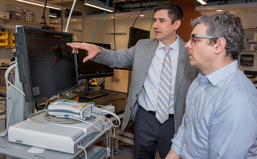 Mass General's Michael Filbin, MD (left), and MIT's Thomas Heldt, PhD, received an MGH-MIT Grand Challenge grant to develop a sepsis warning system.