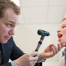 Wayne Shreffler, MD. PhD, examines Connor Fitzpatrick, who has multiple food allergies.