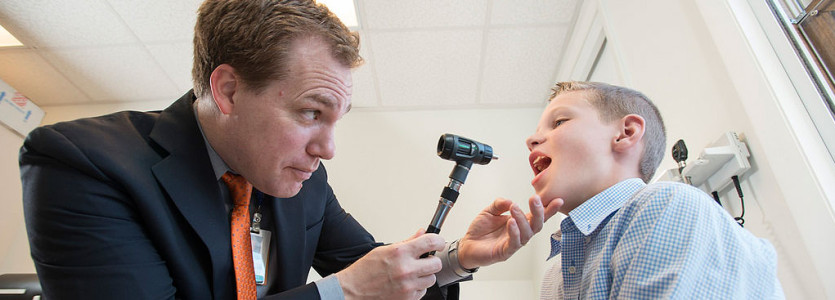 Wayne Shreffler, MD. PhD, examines Connor Fitzpatrick, who has multiple food allergies.