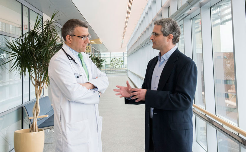 Mass General Cancer Center's bioinformatics director, Gad Getz, PhD (right) confers with Ephraim Hochberg, MD.