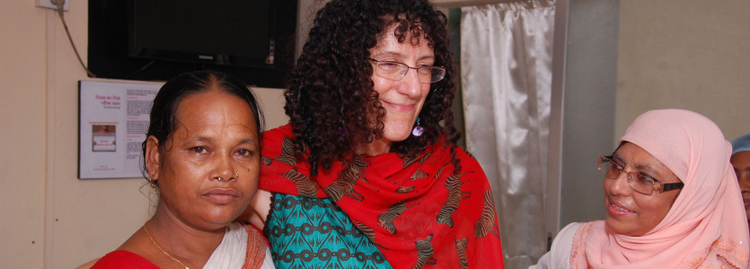 AnneKathryn Goodman, MD (center), works with women in Bangladesh to increase screening for cervical cancer.