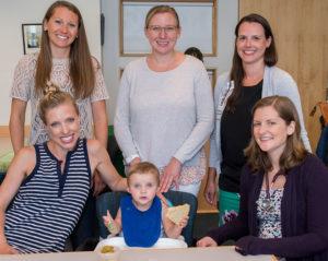 The feeding center team, top row, left to right: Tara Greichen, OT; Sarah Sally, MS, CCC-SLP; Jill Israelite, RD. Bottom row from left, Grant's mother Lindsey Baker, Grant, and Lauren Fiechtner, MD.