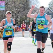 Wearing bibs provided by John Hancock, Ilona and Carl Marino, who are married, ran for Mass General in the 2016 Boston Marathon.