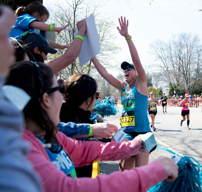 On Marathon Day, friends, family members and hospital staff cheer on members of the Mass General Boston Marathon Team.