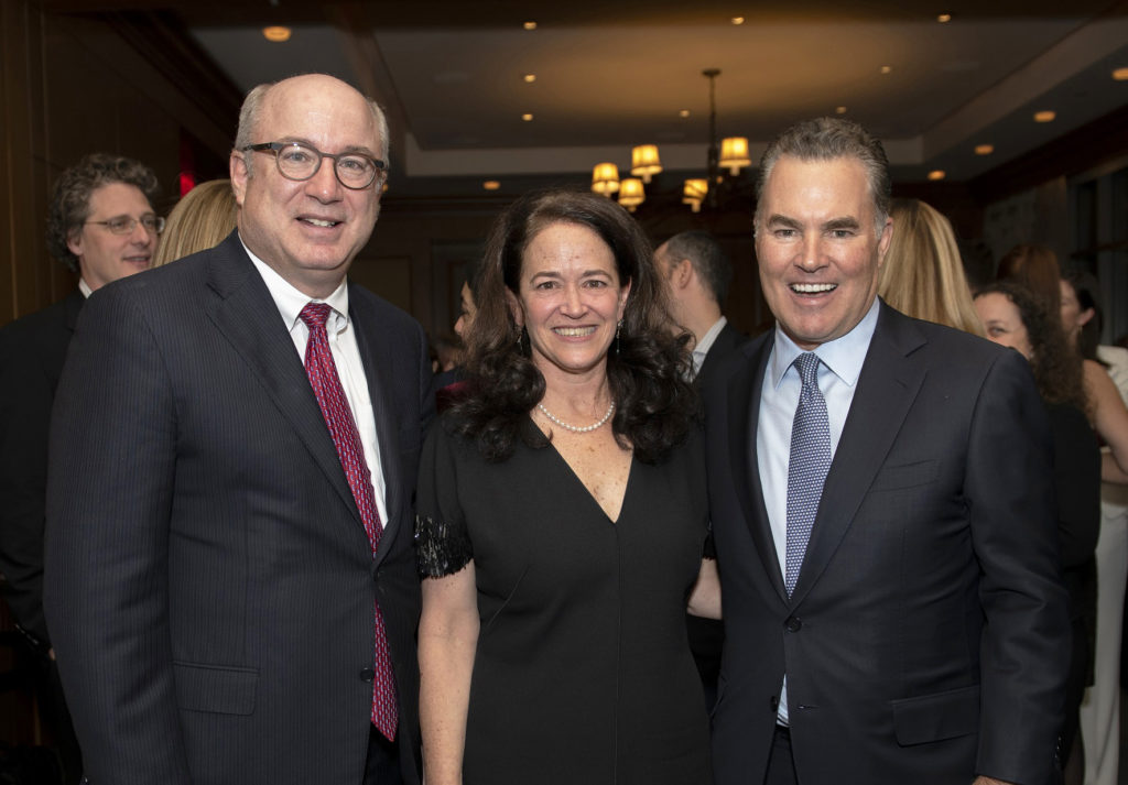 Peter L. Slavin, MD, Mass General president (left), joined Merit Cudkowicz, MD, chief of Neurology and director of the Healey Center, and Sean Healey in celebrating the Healey gift.