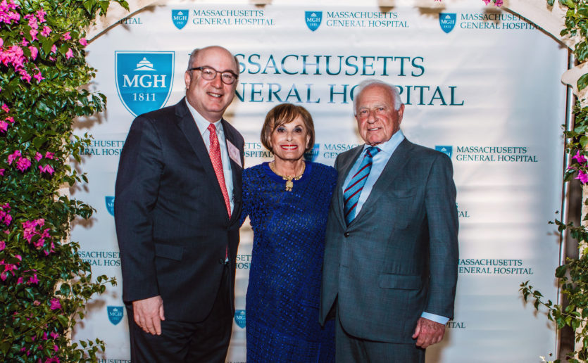 At a reception, Peter L. Slavin, MD, (left), Mass General' s president, personally thanked philanthropists James S. and Carol J. Herscot for a half century of generous support, including a new $50 million gift. (Photo by Alethia Williams)