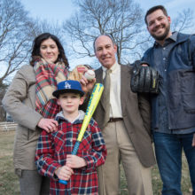 Caitlin and Rich Hill, with their son Brice, are happy to support the work of David Sweetser, MD, PhD (center, wearing tie), who helped solve their family's genetic mystery.