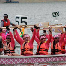 To increase awareness of breast cancer, Dr. Houriya Kazim and her teammates compete in Penang International Dragon Boat Festival in Malaysia.