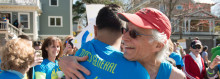 Howard Weinstein, MD, MGH Boston Marathon team captain, embraces his 2014 patient-partner Lorenzo Tejada, at Mile 20.