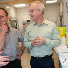 From left to right: Bradley  Hyman, MD, PhD, Brian Bacskai, PhD, and Mark Albers, MD, PhD discuss a research project in Dr. Hyman's laboratory.
