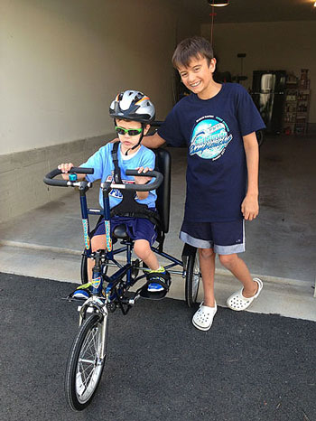 Under Dr. Thibert's care, JP (pictured with his brother, Sam) eventually began to walk and ride a bicycle.