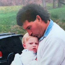 A young Zack Johnson with his father, Jeff, at his Canandaigua, NY home. Photo by Pamela C Johnson.