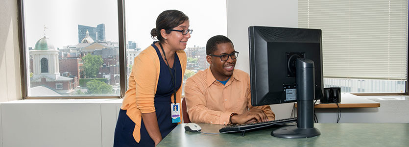 Avni Khatri, left, program manager for the Knowledge and Learning Technologies Group, works with Jeanmarie Metelus Jr., an MGH Youth Scholars Alumnus.