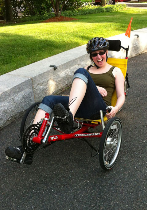 Jessica Peters working out on her recumbent bike.