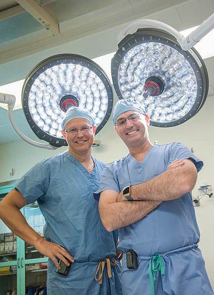 Cardiologist Greg Lewis, MD, (left) and cardiac surgeon David D'Alessandro, MD, led the Mass General effort to get Dennis Kaminski the heart transplant that he needed.