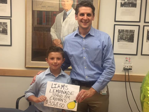 Liam Doherty, pictured with his doctor, Jess Kaplan, MD, visited Mass General recently to present a donation of more than $3,000.