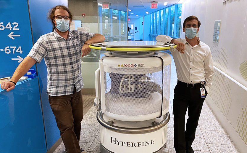 Matt Rosen, PhD and W. Taylor Kimberly, MD, PhD, shown with the Hyperfine portable MRI now is use at Mass General.